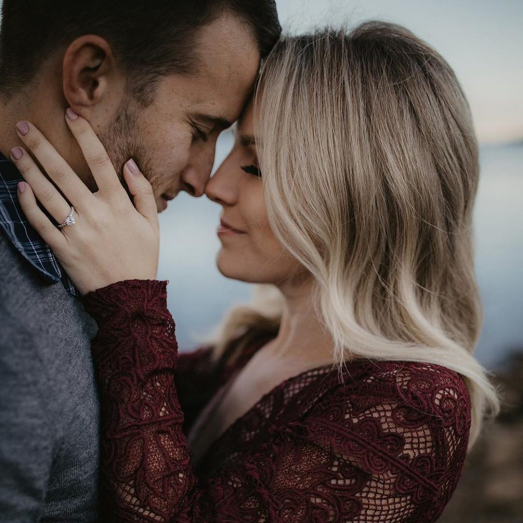 couple embracing newly engaged